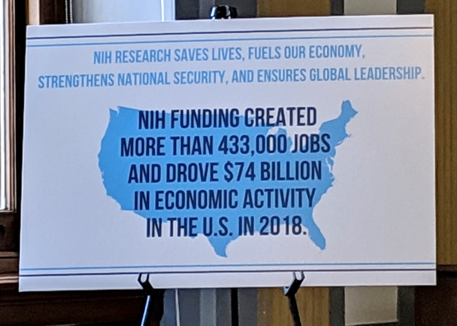 An NIH poster at the briefing.